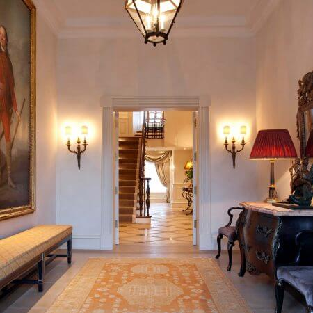 A large entrance way interior for a grand regency home