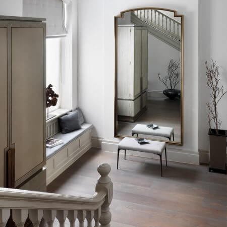 Looking down the stairs towards elegantly styled hallway